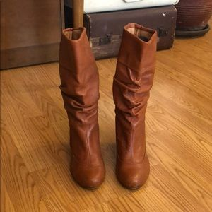 Brown mid calf leather boot.